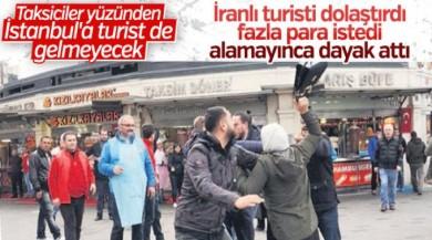 Taksicinin turistlerle taksimetre kavgası